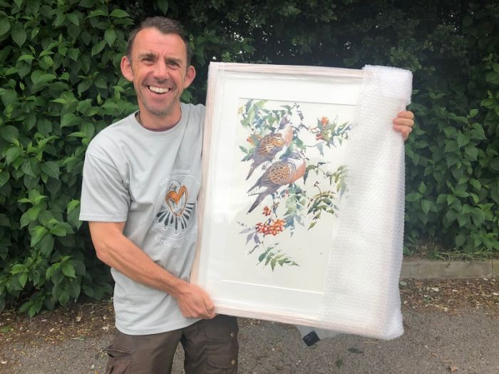 Darren Woodhead holding his stunning Turtle Dove art for sale in the exhibition